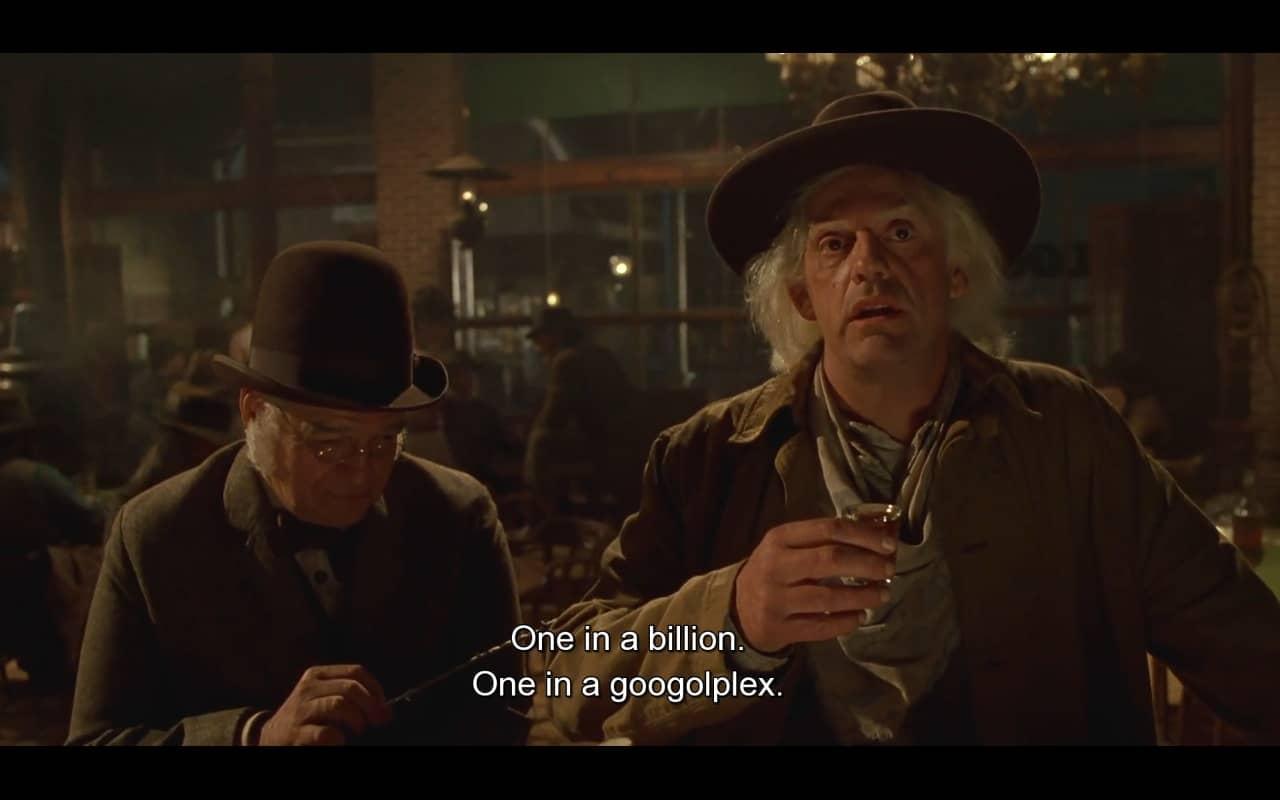 Dois homens, um deles melancólico com copo de bebida alcoólica na mão