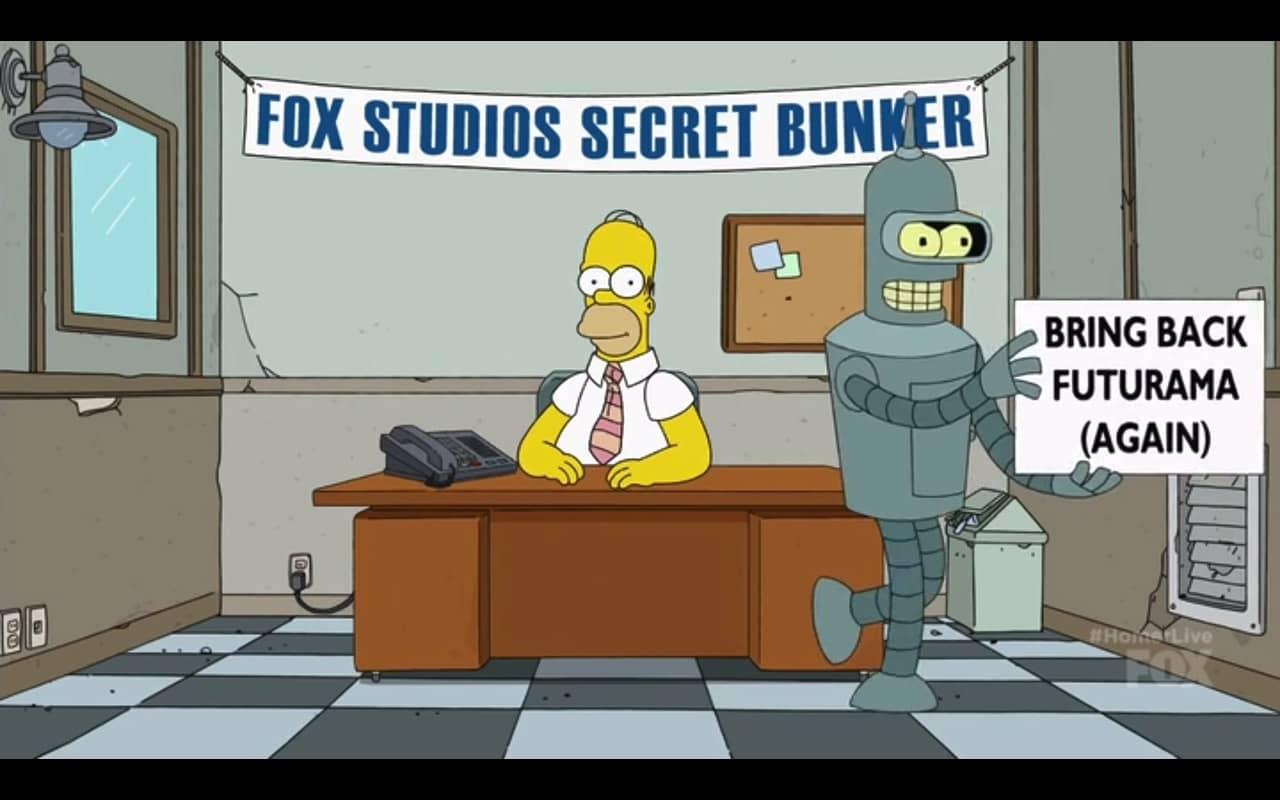 desenhoi: robô passa na frente de um mesa, segurando a placa Bring Back Futurama (again)