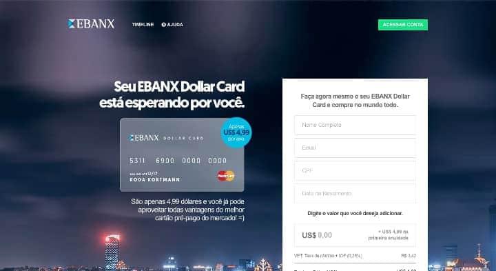 imagem cartão de crédito Dollar Card Ebanx ao lado de formulário sobre uma vista de uma cidade iluminada